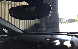 Image: Dash Camera Fitting Hidden Behind Rear View Mirror